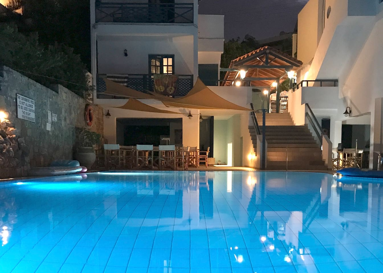 Swimming pool area right after sunset. The best time for a swim and glass of wine/ beer accompanied by Cretan varieties of cheese we love to share.