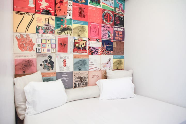 Vinyl wall in bedroom #2- a nook with no wall with a full size bed.