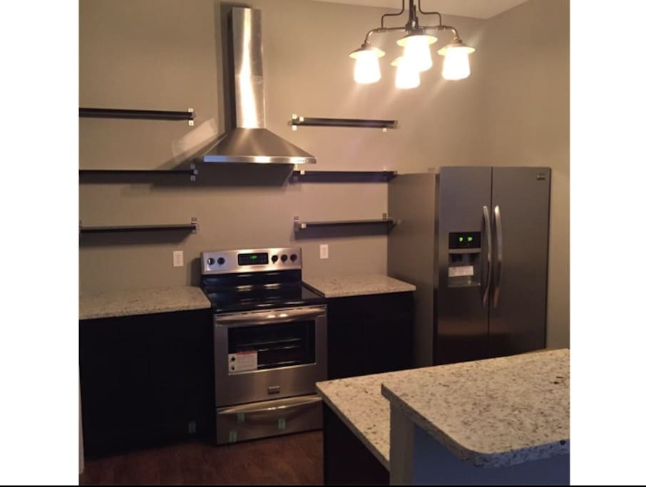 Kitchen comes with electric stove, microwave, oven, fridge and dishwasher.
