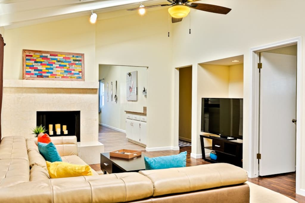 Large, colorfully accented family room to enjoy a movie or simply relax.