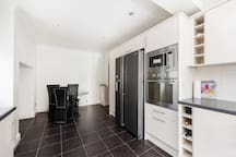 Kitchen with dining and American style fridge freezer