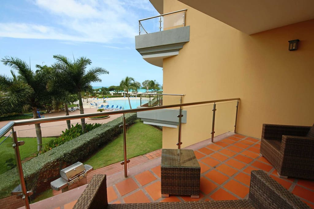 Living area balcony with great ocean and pool view