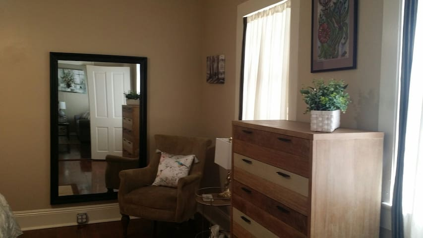Bedroom with full length mirror and dresser