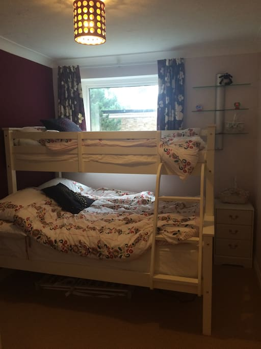 Second bedroom with a triple bunk bed, perfect for a couple or 3 children.