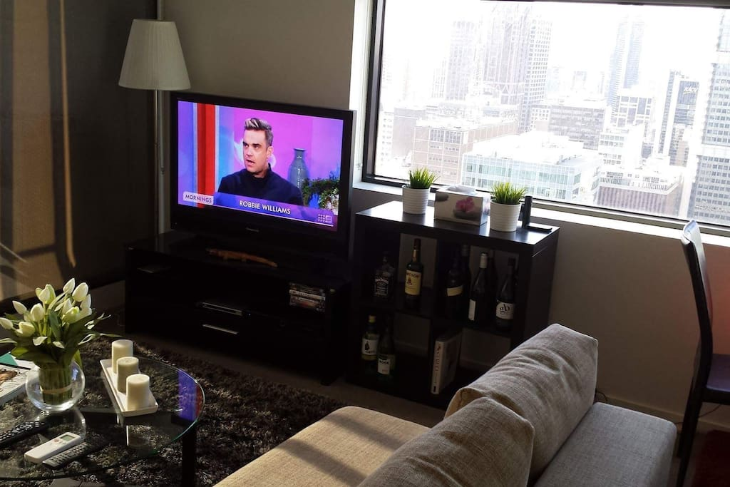 Lounge sofa area with full Foxtel tv