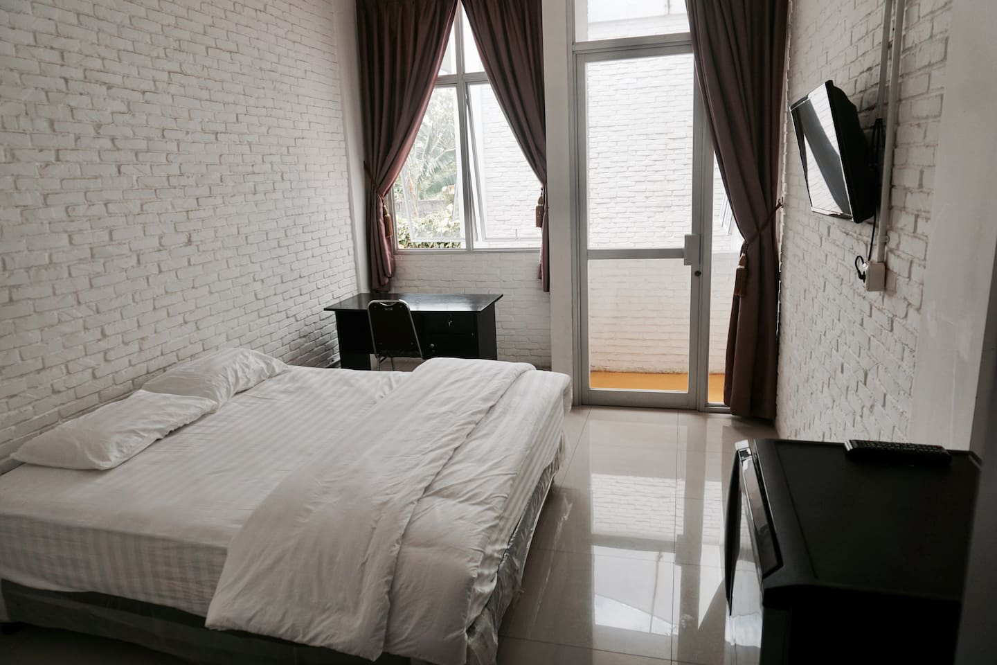 Single Bedroom with AC, Flat TV, refrigerator, work desk, and private bathroom