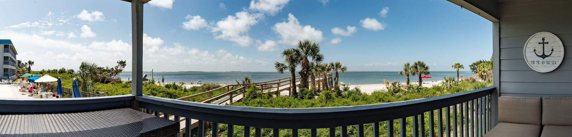 Beachfront condo with excellent views of water, dolphins and shrimp boats! This view is from the balcony and main windows in the living room