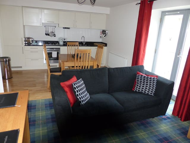 Lounge showing kitchen and dining area