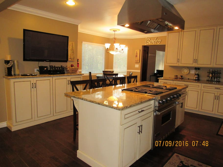 Kitchen w/center island and flat screen TV