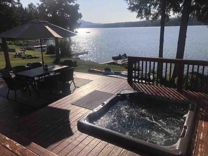 Stunning lakefront home on Deka Lake with hot tub.