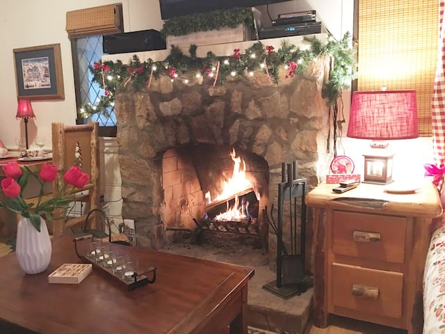 Build a roaring fire in the wood burning fireplace with gas