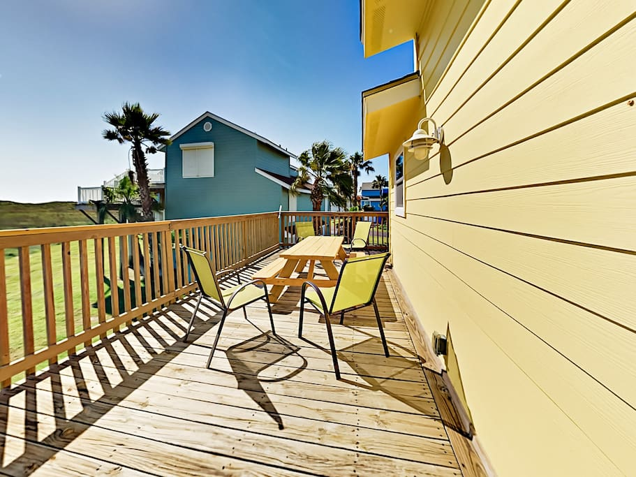 Breezy 2nd-floor balcony with picnic table and ample seating.