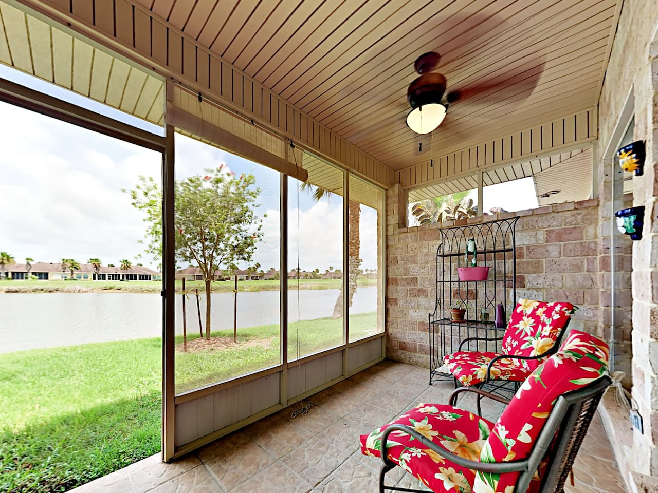 Lake views from the screened porch. This property is maintained and managed by TurnKey Vacation Rentals.