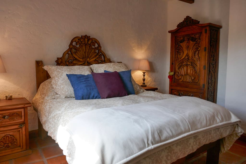 Master bedroom with a queen size bed and Juliet balcony