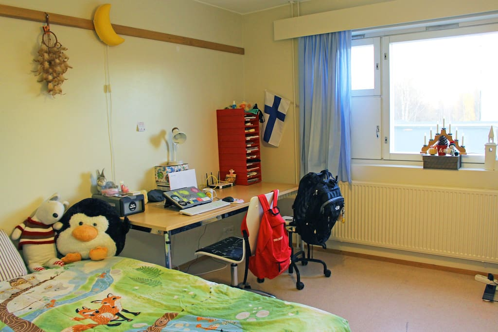 Working place for two (or even three, since the table is very big) is right next to the bed.