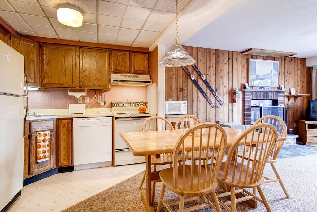 The dining table and kitchen