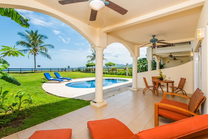 Beach Front Condo w/ Pool! Budget Friendly! Amazing Sunsets!