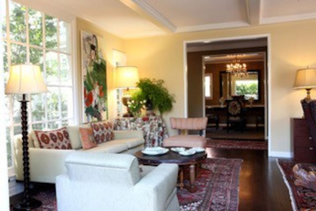The living room has three seating areas.