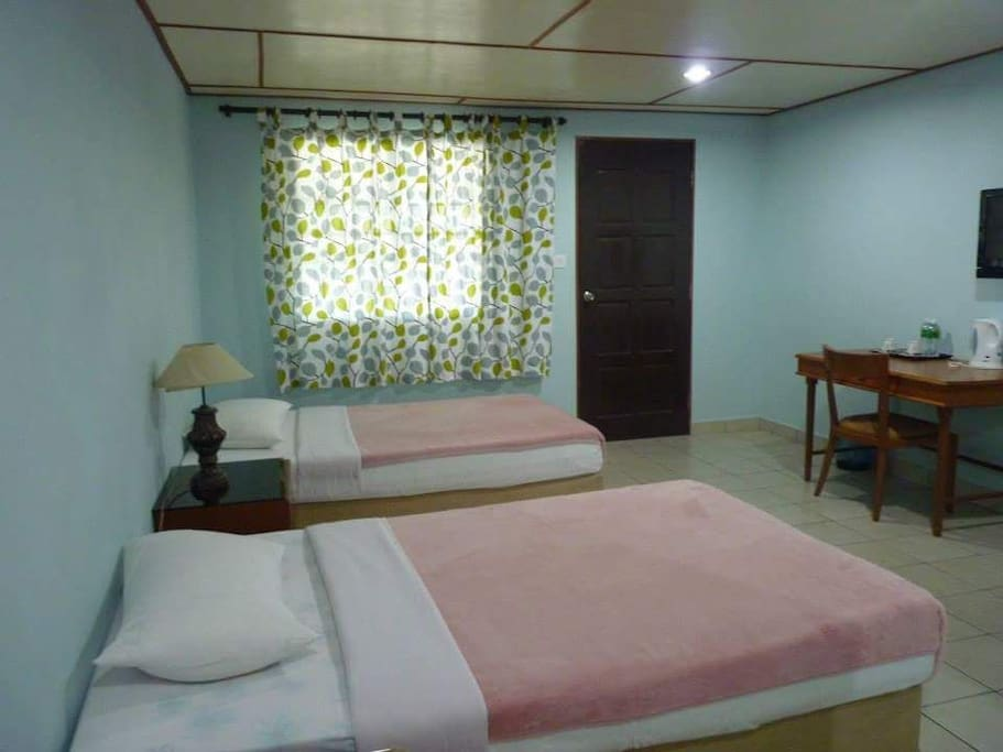 Twin room with 2 single bed and attached bathroom
