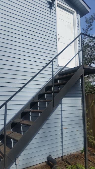 Stairs to your private studio living area in the carriage house.