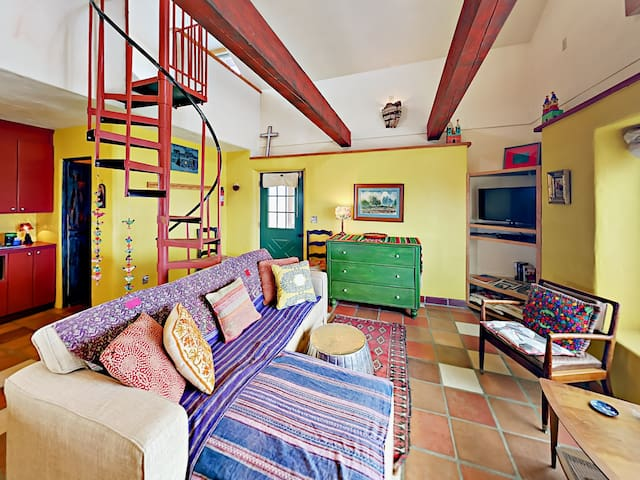 High ceilings and colorful Southwestern decor create a welcoming vibe throughout this rental.