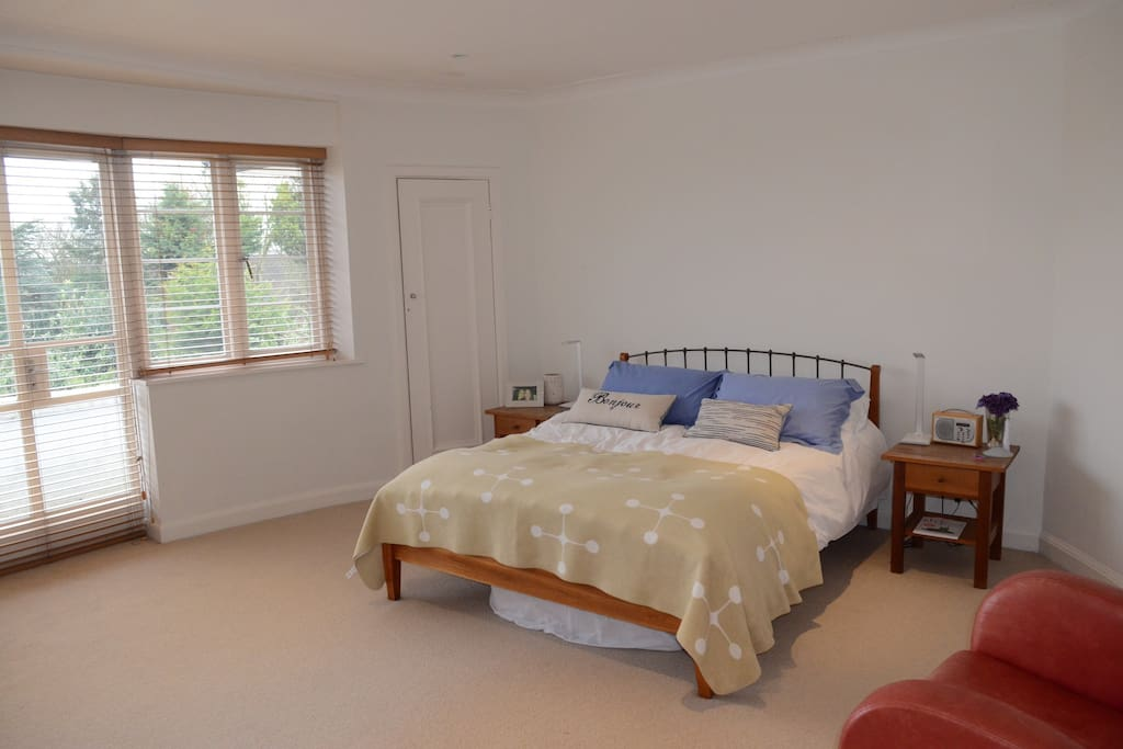 Double bedroom on 1st floor with balcony and great views across South London.