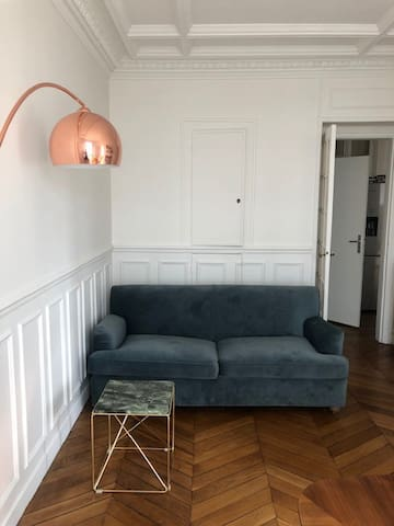 Living room with a couch that extends to full bed 160X200cm