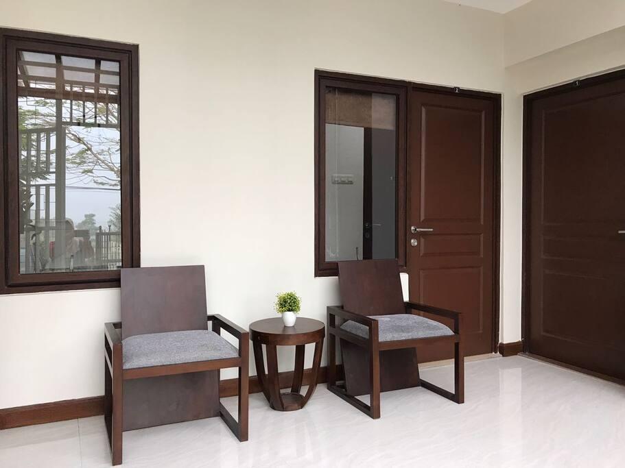 Terrace in front of Room 2.  Room 2 door is at left and the rightmost is door of Room 1.