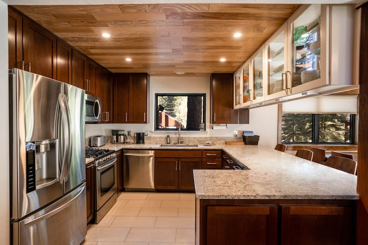 Fully stocked kitchen with granite counters and breakfast bar