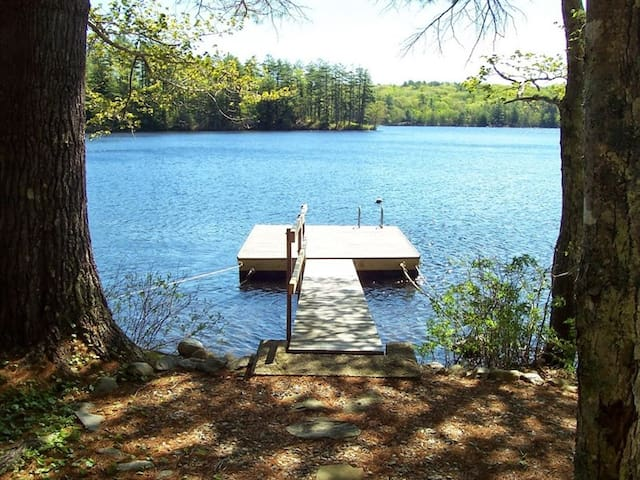 Peaceful cottage on Damariscotta Lake in Newcastle Maine with Bunkhouse fire pit and dock