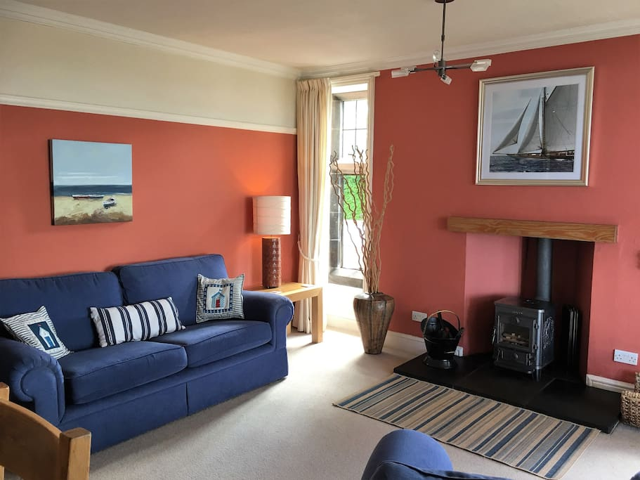 Spacious Lounge and log burner