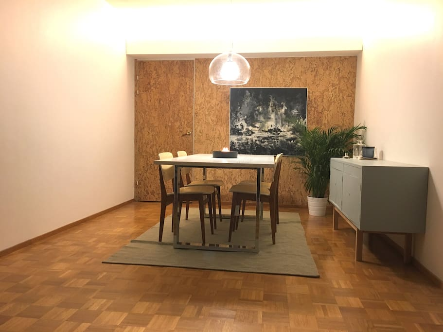 Enjoy your meals in the funky setting of the dining room, equipped with a  kork wall from 1960, abstract art and a table that will easily fit 8.