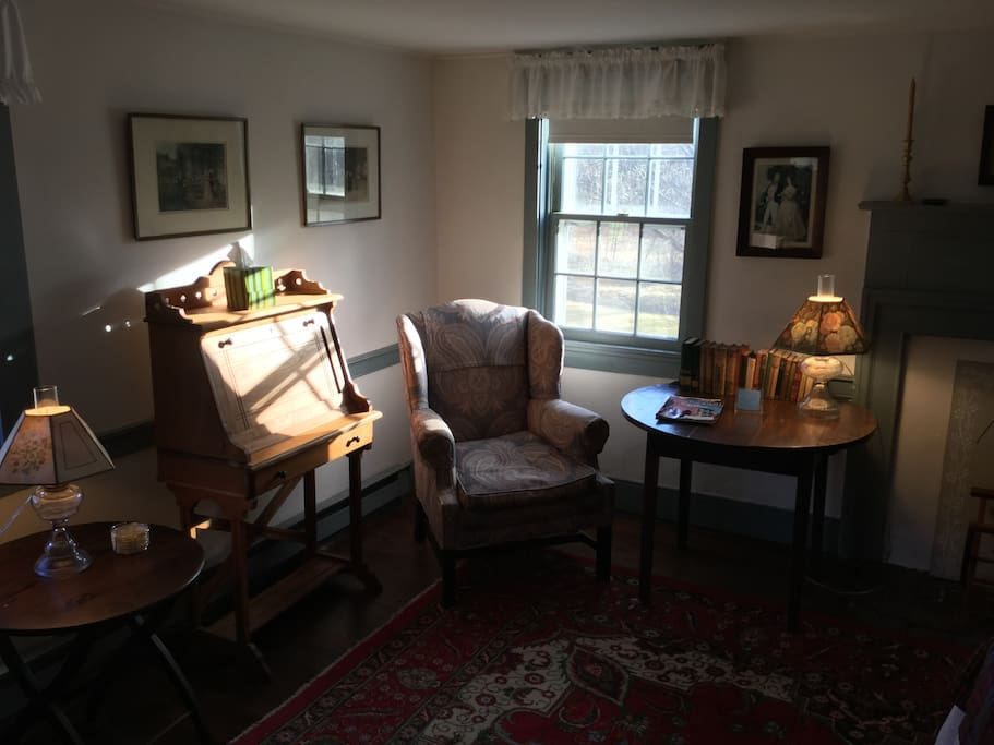 Mary Street's writing desk, comfortable reading chair, table