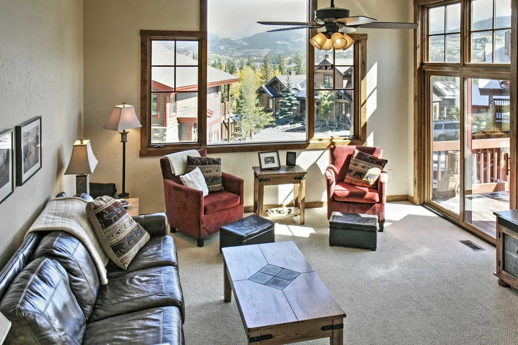 Spread out in the bright and inviting living room with lots of windows that allow natural light to fill the room.