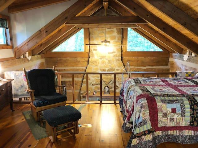 Open loft overlooking living room fireplace.