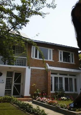 Home with spacious beautiful greeneries