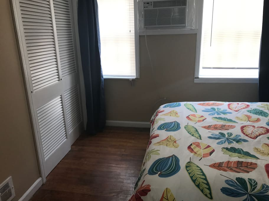 View across first bedroom, Large windows.