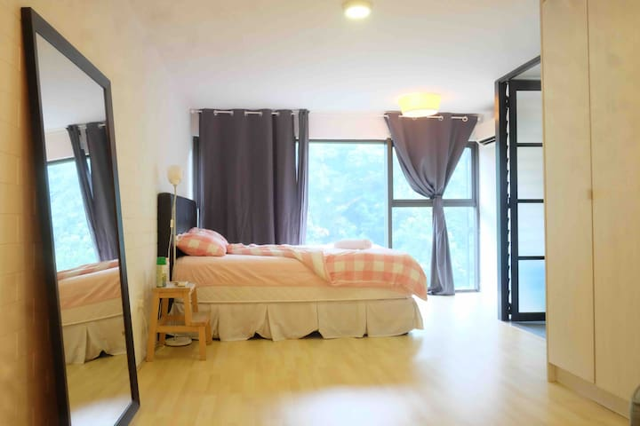 Lie down on the plush queen bed. The big windows let in plenty of light while you enjoy the green hill view and forget that you're in the city. You could also sleep in on a lazy day with the black-out curtains drawn.
