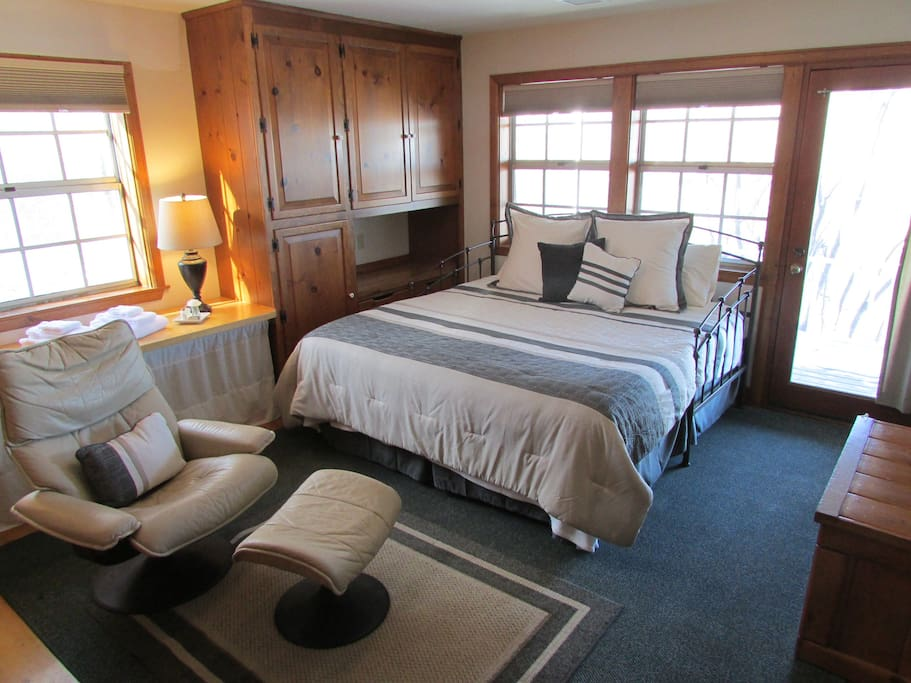 The King/Deck Room is one of 4 rooms available. It features a king bed , lounge chair and private entrance from spacious deck .