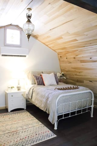 Open bedroom with full size bed
