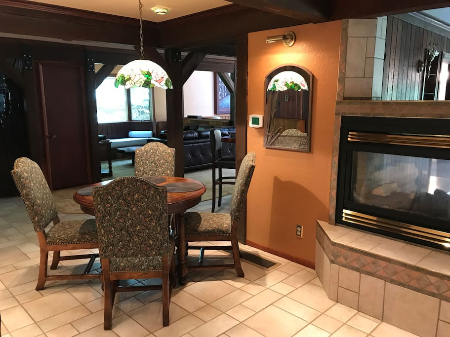 Multi purpose table off kitchen & gas fireplace