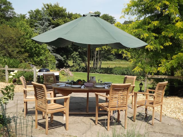 One of two BBQ Terraces with a large fire pit overlooking the River Frome  and gardens at River House.
