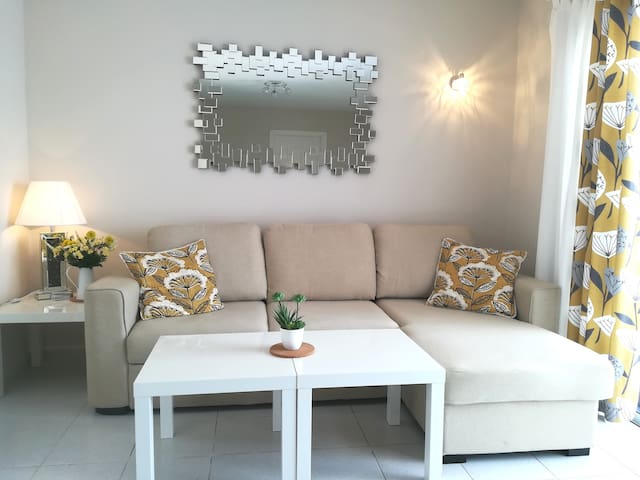 Beautiful stylish apartment very central, only 3mins walk to the beach and restaurants, 10 minute drive from the airport.  This is a ground floor one bedroom with twin beds, sofa bed in lounge, kitchen, bathroom and large terrace plus sun loungers.