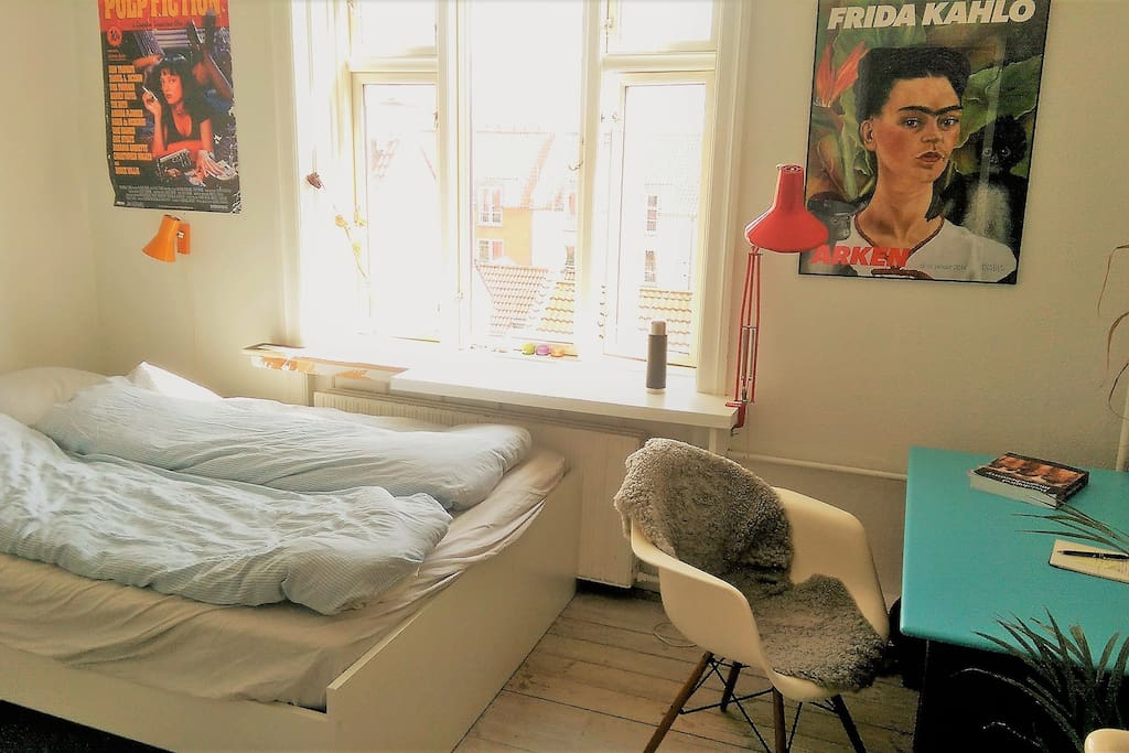 Master bedroom with a double bed and lovely view to a quiet street