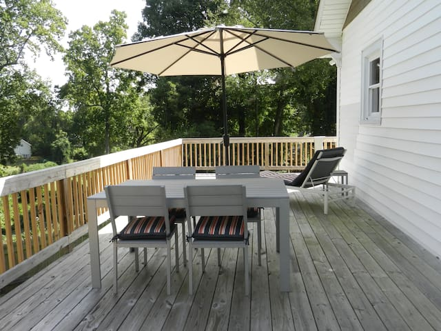 Enormous rear deck for enjoying a family gathering.  Deck is gated to prevent your furry friend and little kids from accessing the stairs.
