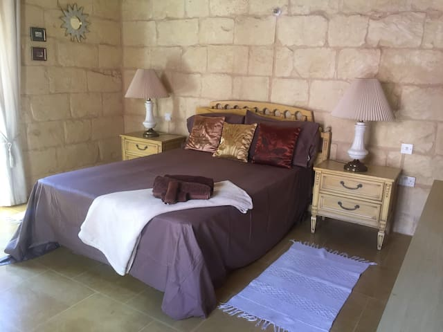 Spacious double bedroom with en suite and pool