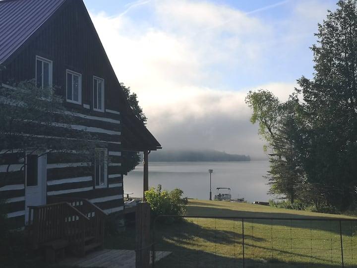 Four bedroom log home on Norcan Lake