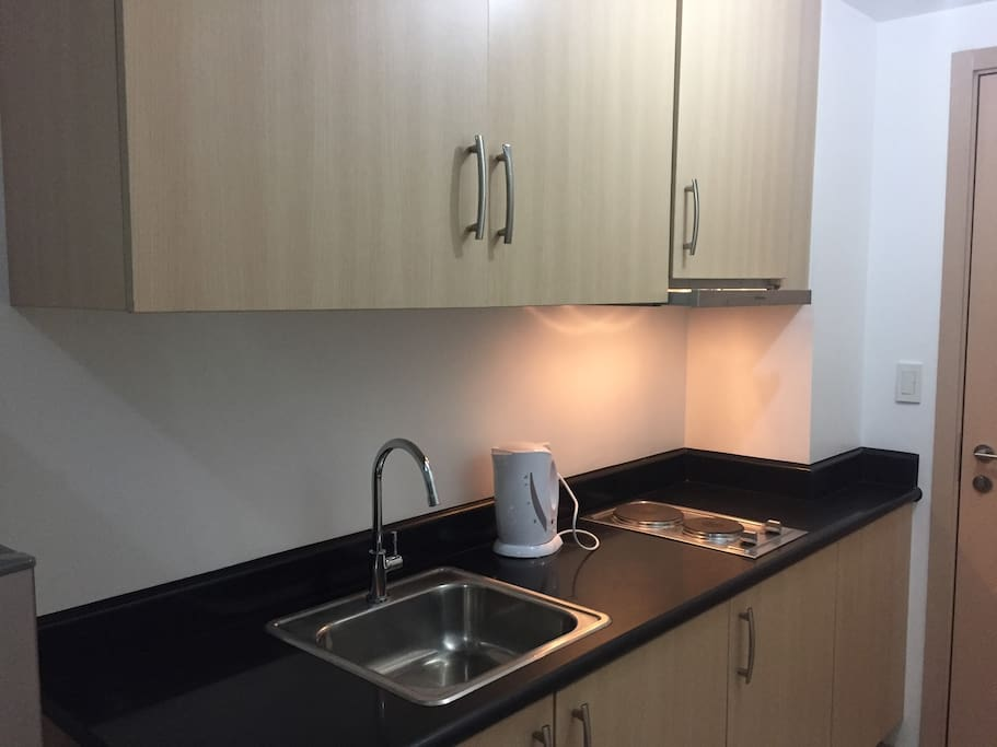 Kitchen with electric stove, hood range and electric kettle