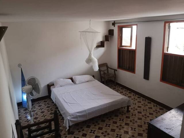 Spacious double bedroom with private bathroom.