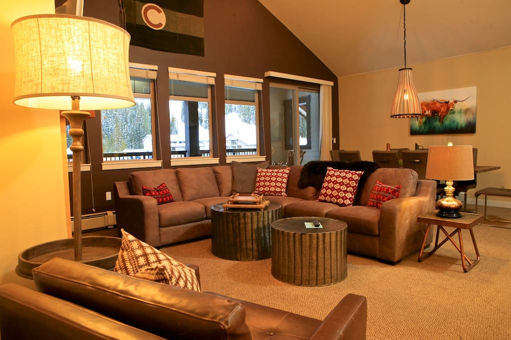 Sink into the brand new sectional and relax by the fire.